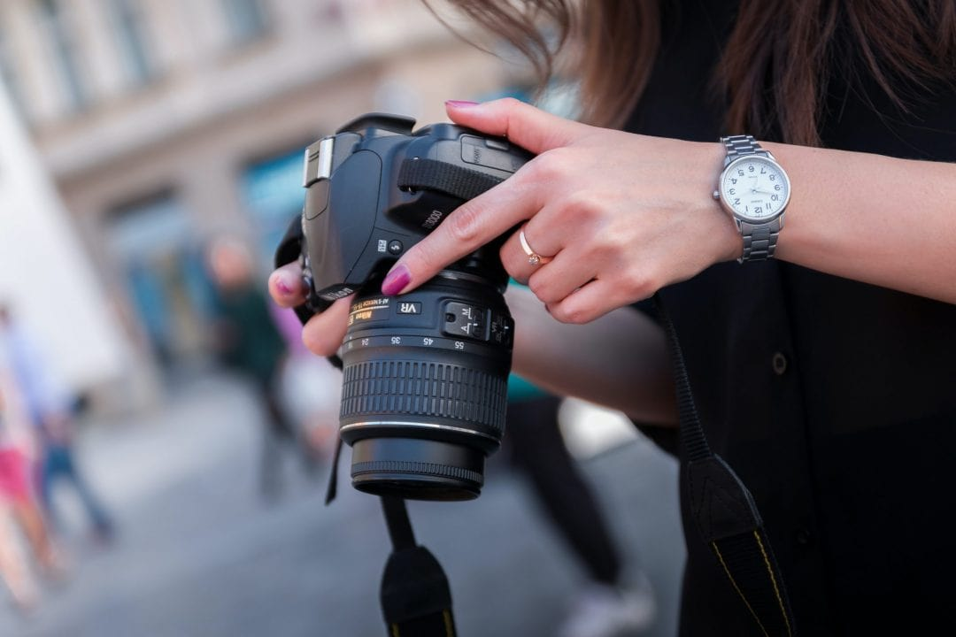 Beginner holding a camera