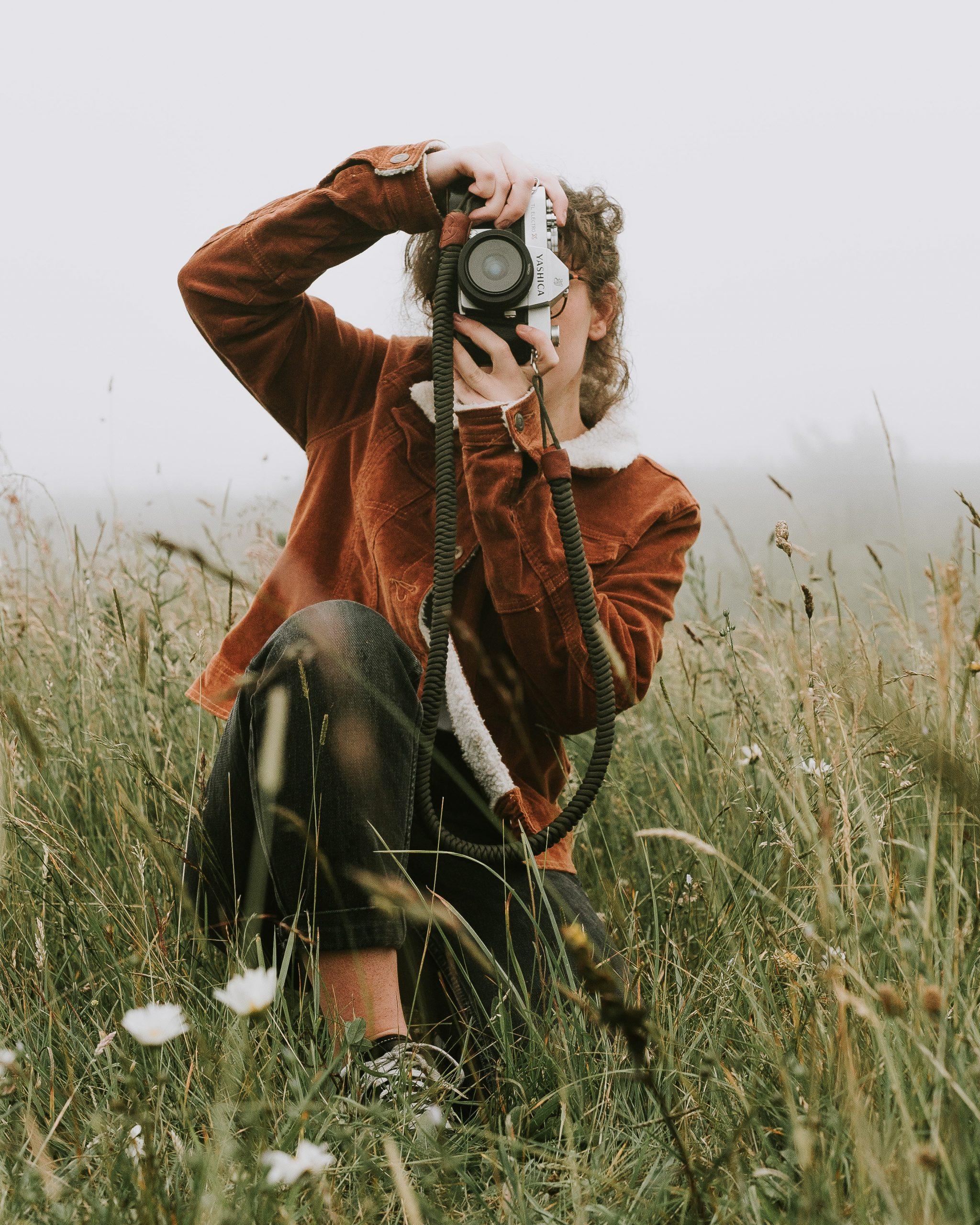 Intermediate photographer in field